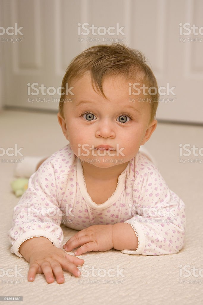 People - Serious Crawling Baby stock photo