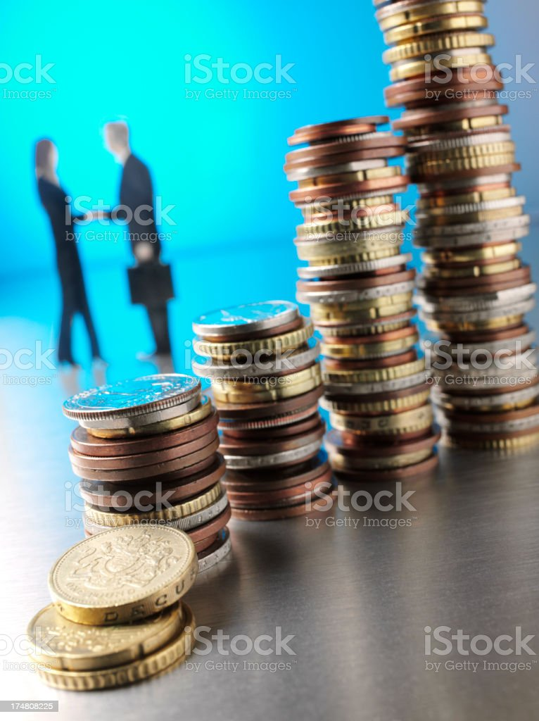 People Shacking Hands with a Coin Tower royalty-free stock photo