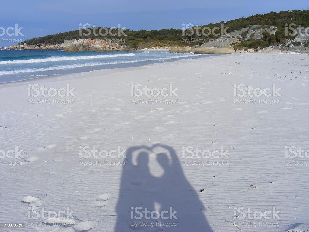 People Shadows Love heart on the beach stock photo