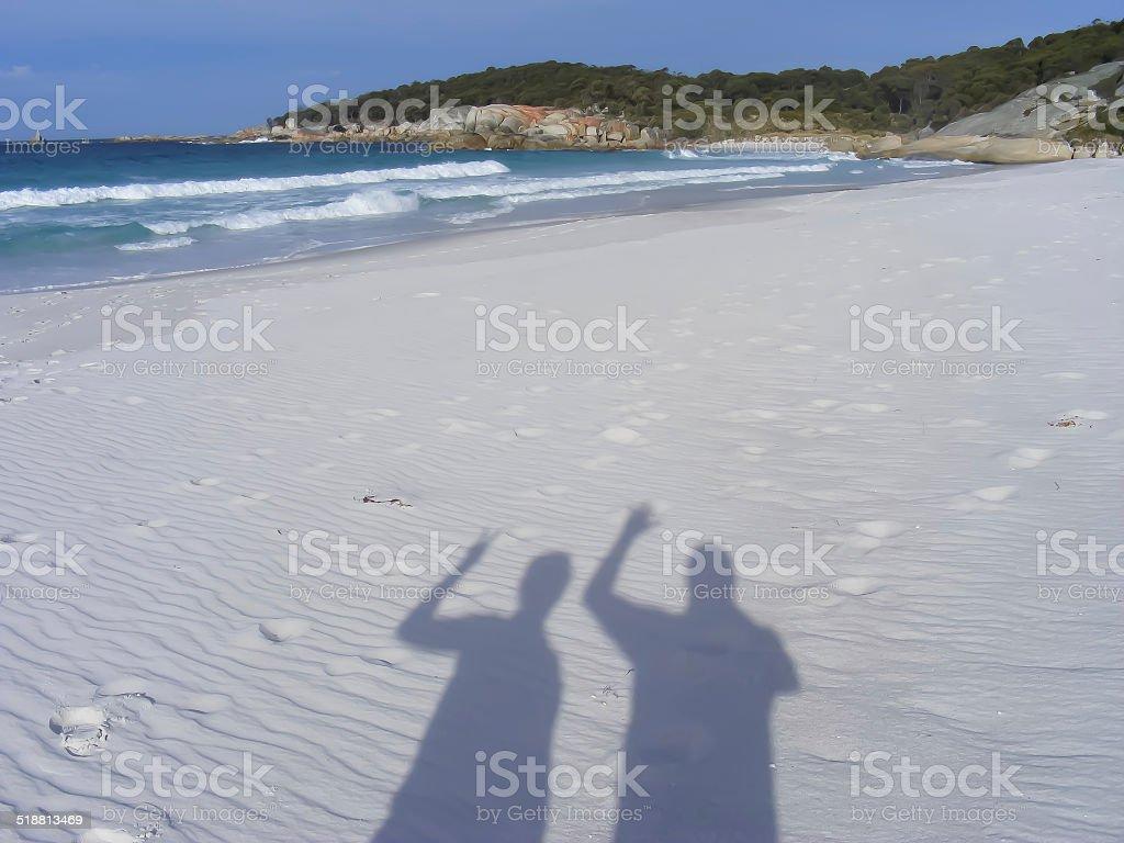 People Shadows Waving on the beach stock photo