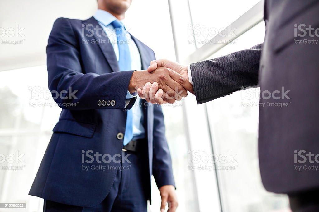 People shaking hands stock photo