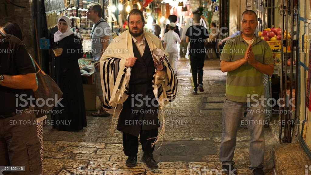People sharing the streets of Jerusalem stock photo