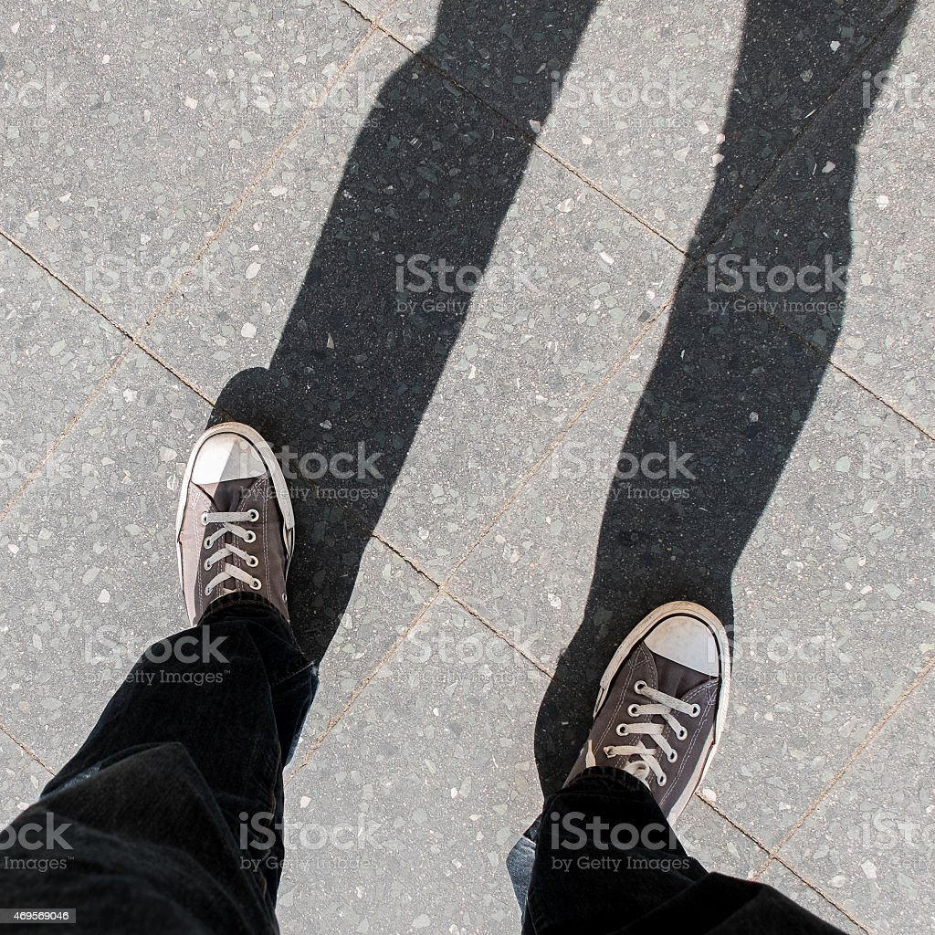People shoes standing on the asphalt stock photo