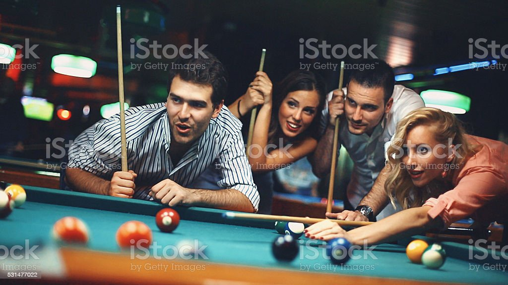 People shooting pool. stock photo