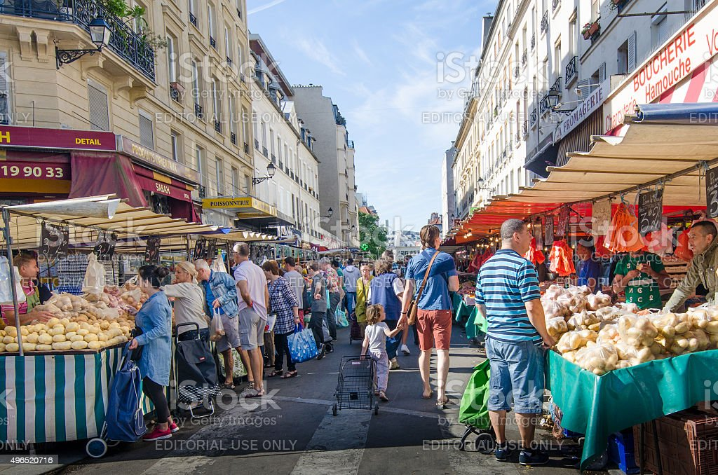 People shop for fresh produce at Marche d'Aligre in Paris stock photo