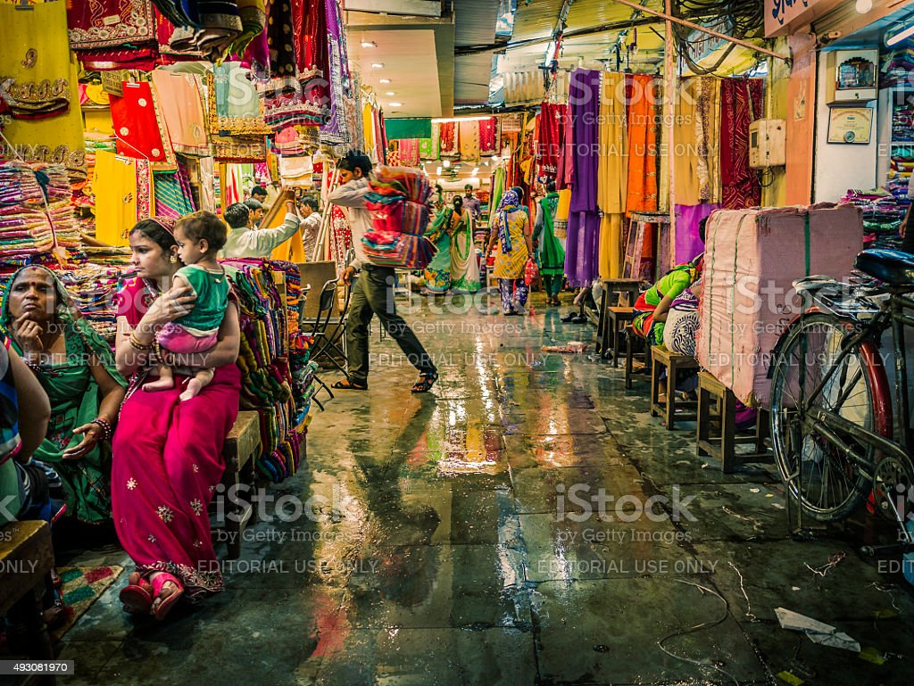 People shoping clothes in bazaar in Jaipur India stock photo