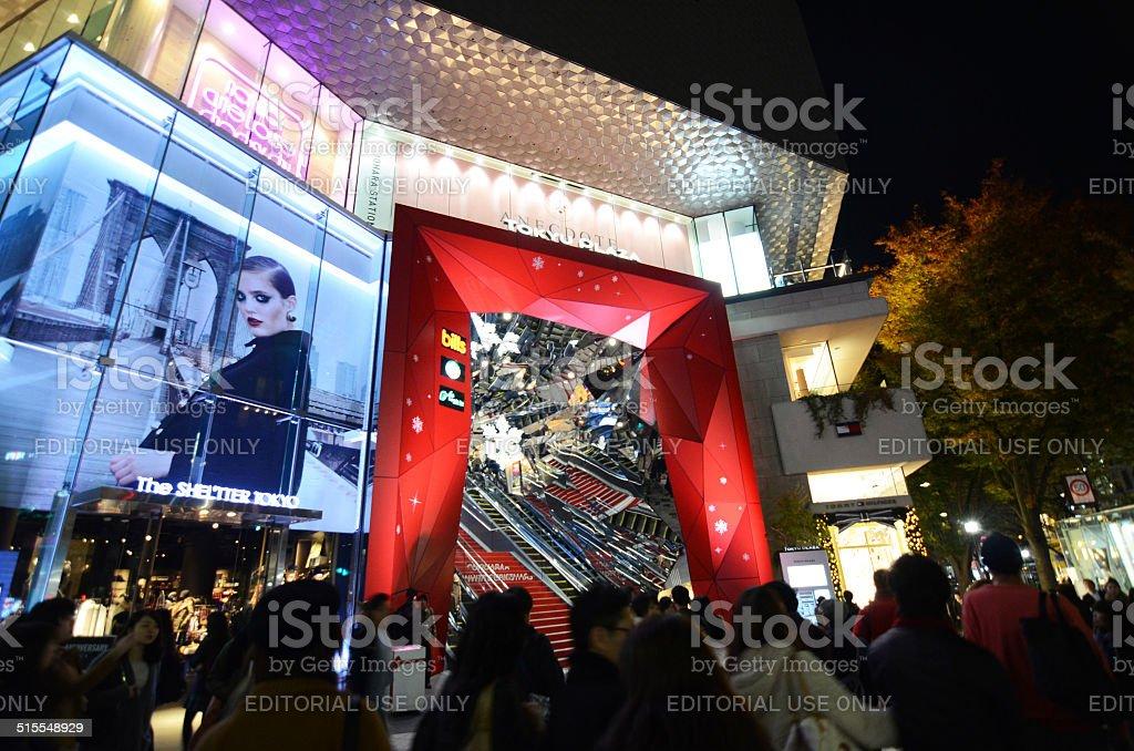 People shopping around Retail shops on Omotesando Street at night stock photo