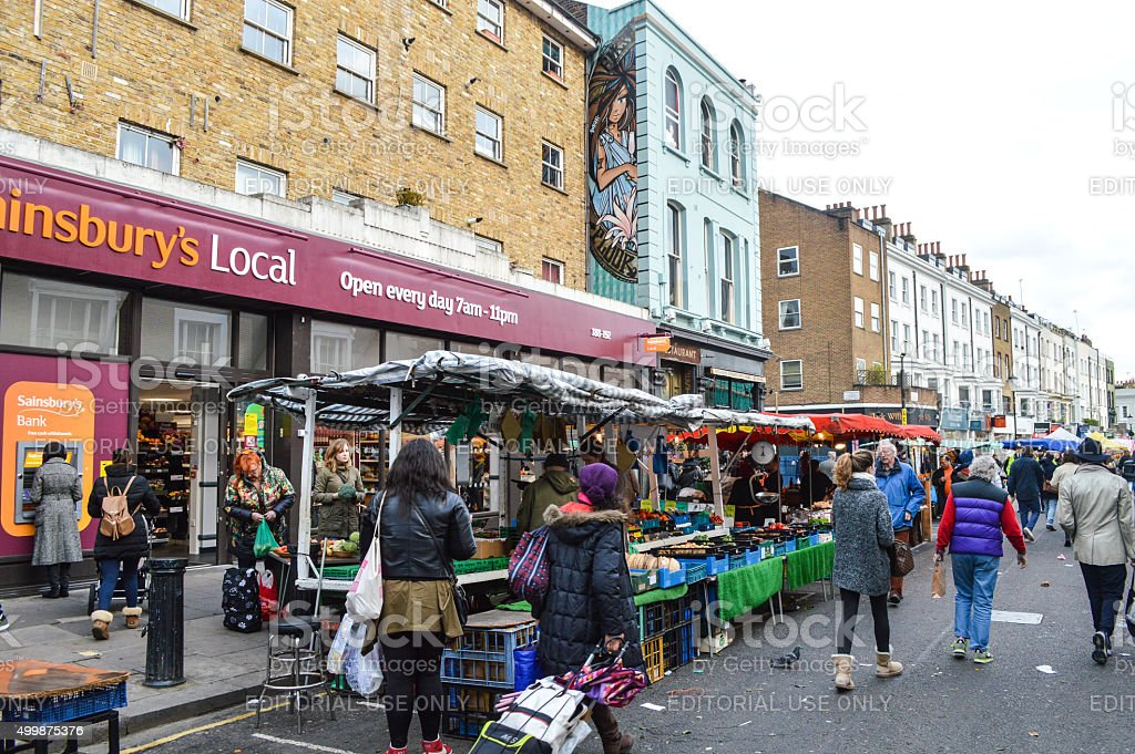 People shopping at Portobello Road Market - London, UK stock photo