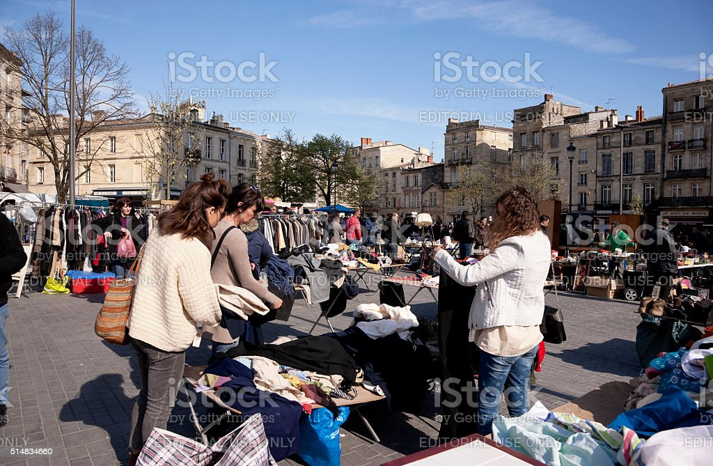People shopping at the flea market stock photo
