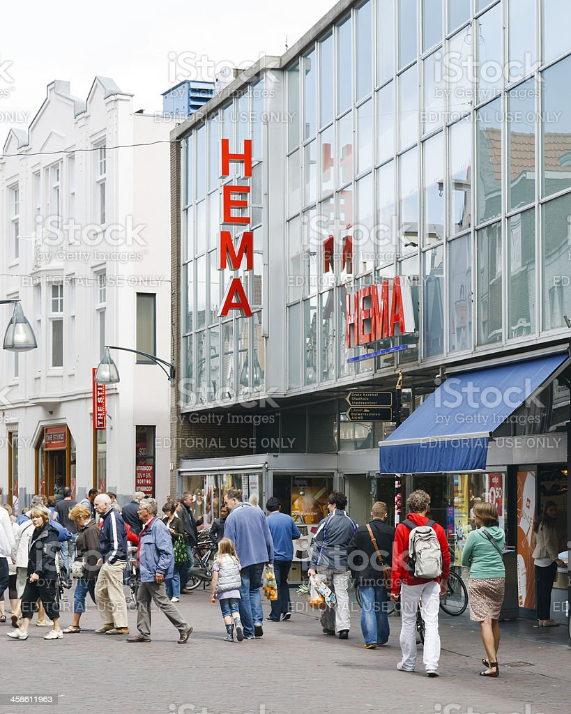 People shopping downtown Deventer in front of local Hema store stock photo