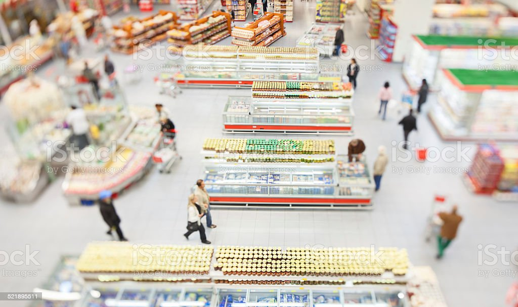 People shopping in a large supermarket stock photo