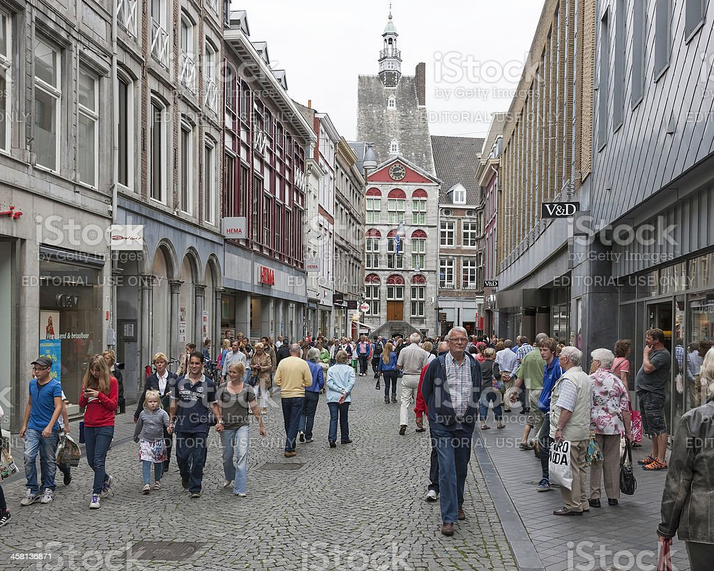 People shopping in a street downtown Maastricht, the Netherlands stock photo