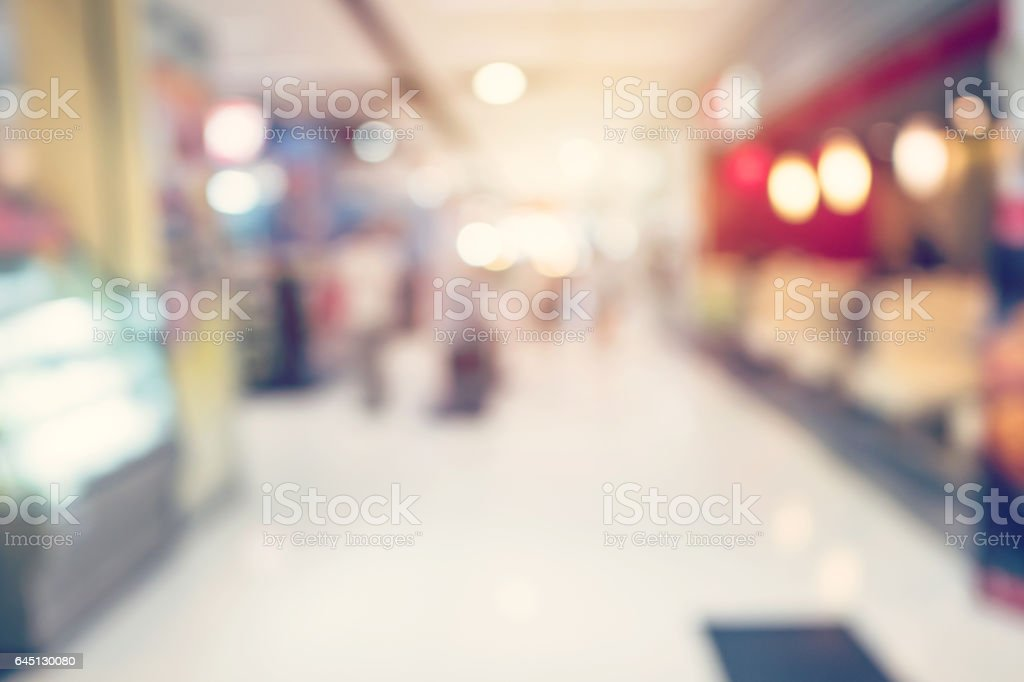People shopping in department store. Defocused blur background. stock photo