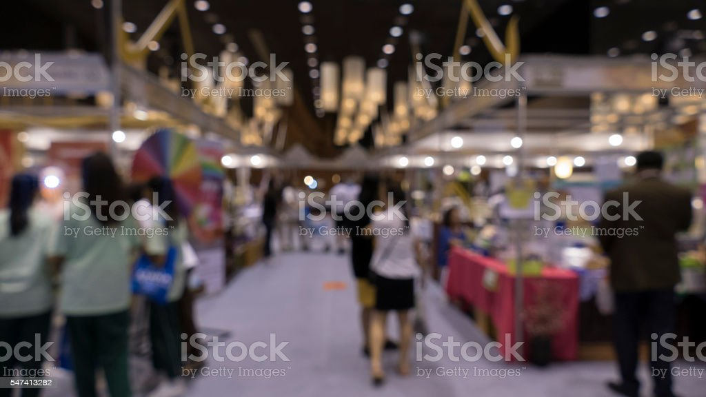 people shopping in exhibiton trade fair - blur stock photo