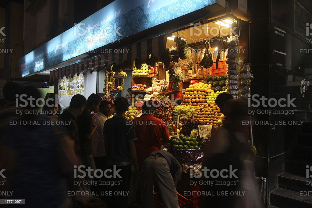 People shopping in local shops on Chikkapete Street, Bangalore, India royalty-free stock photo