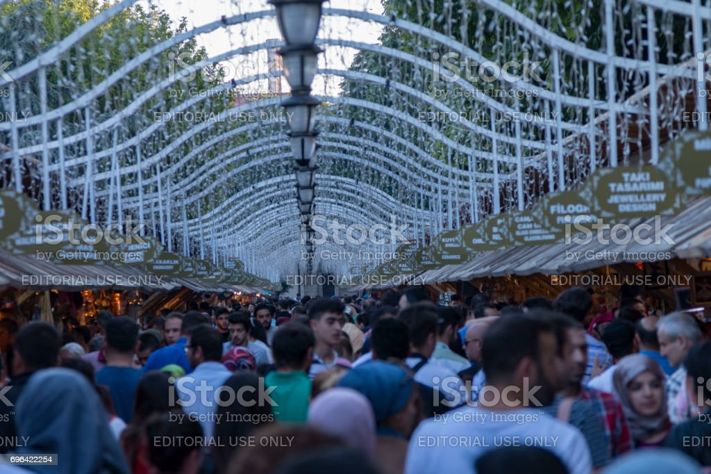 People shopping in Ramadan bazaar in Sultanahmet square. Sultanahmet district is the most popular place for Ramadan activities in Istanbul. stock photo