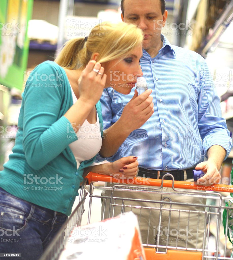 People shopping in supermarket stock photo