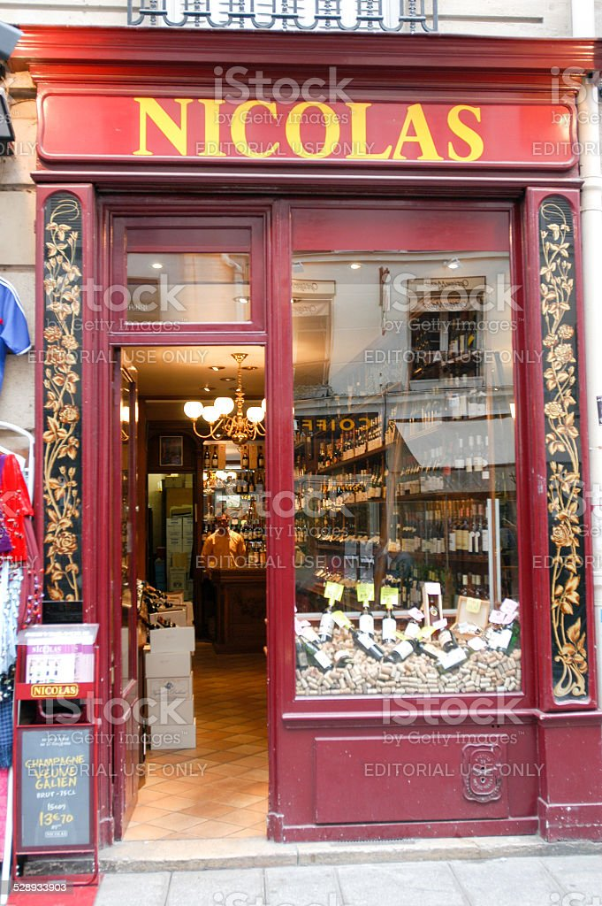 People shopping on a wineshop of Paris stock photo