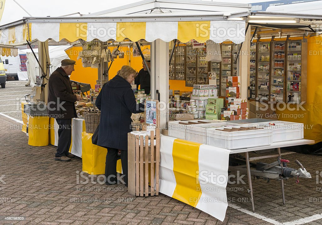 people shopping on the market royalty-free stock photo
