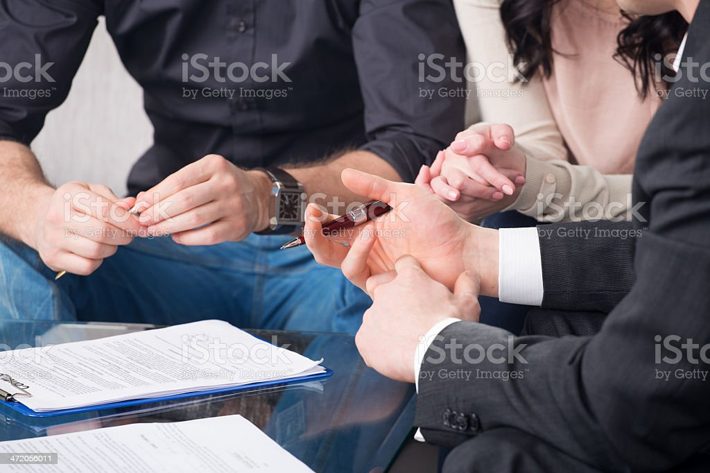 people signing a document stock photo