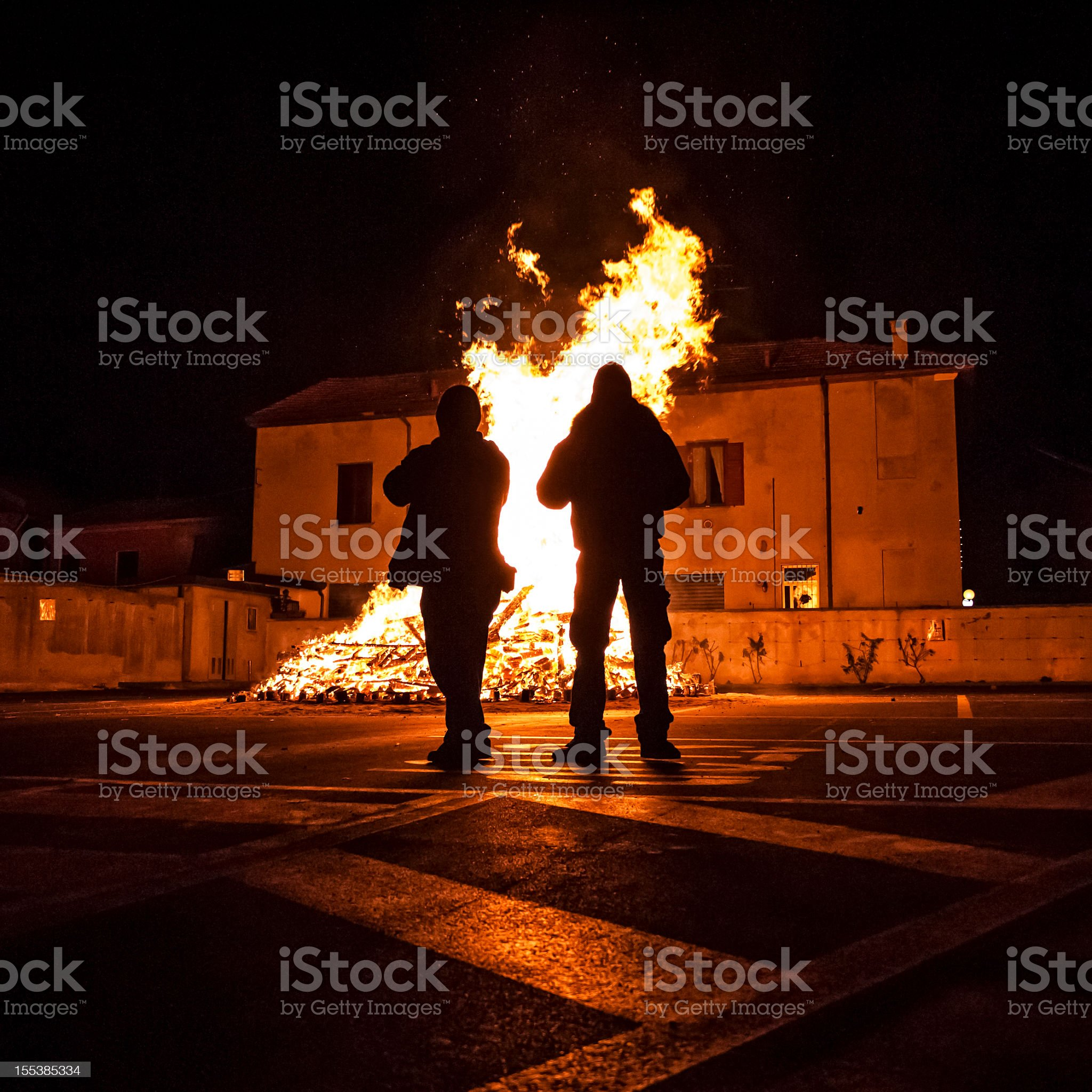 People Silhouette Against Bonfire royalty-free stock photo