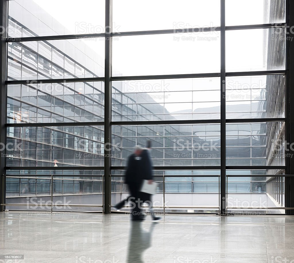 people silhouette in hall of office building royalty-free stock photo