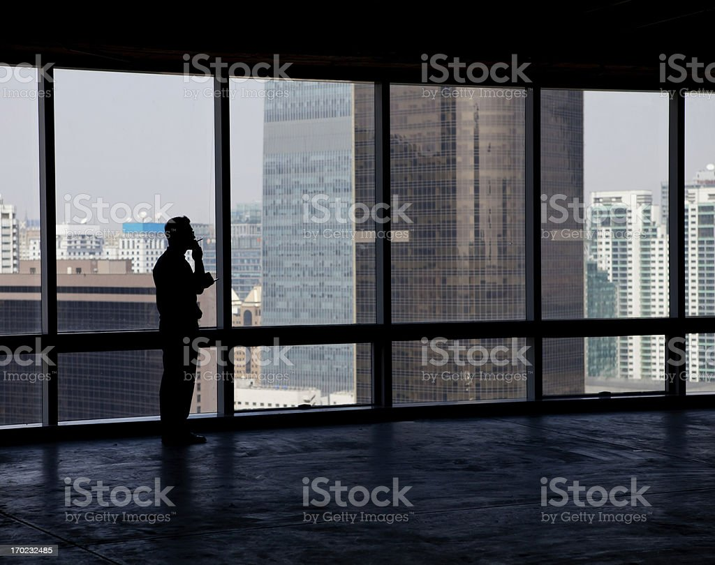 People silhouettes at windows royalty-free stock photo