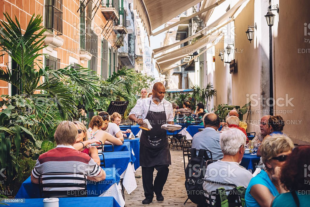 People sit at a Cafe Restaurant in Havana, Cuba stock photo