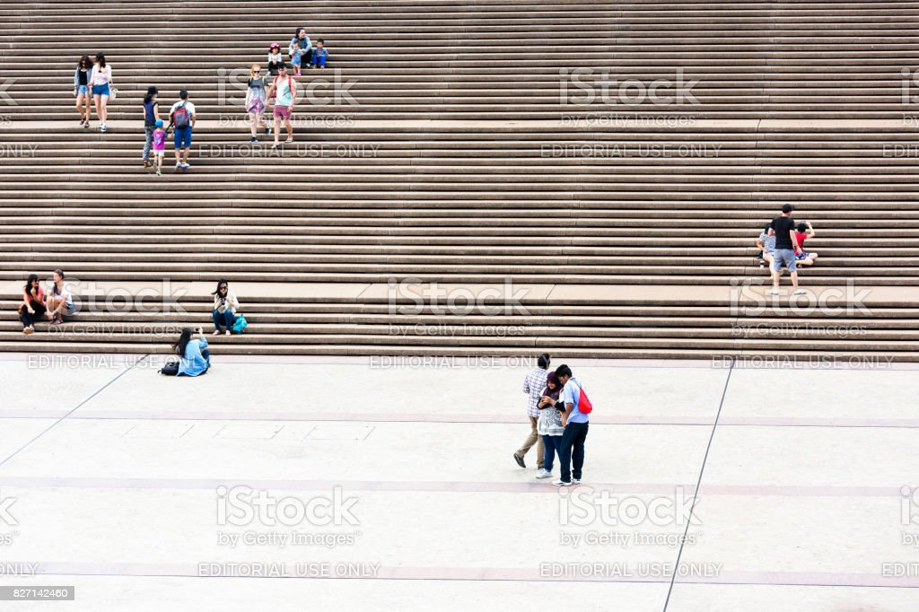 People sitting and walking on steps, copy space stock photo