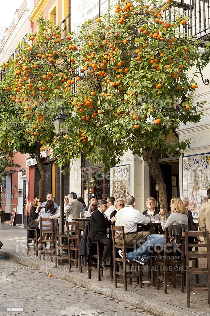 People sitting at a cafe in Seville stock photo