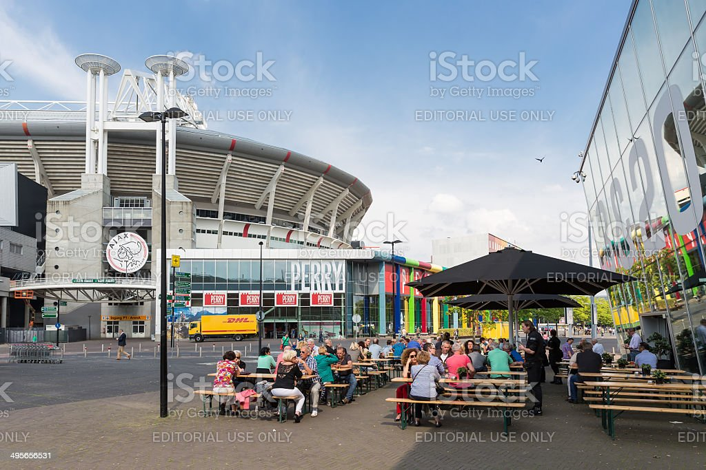 People sitting at a terrace near Dutch soccer stadium Amsterdam stock photo