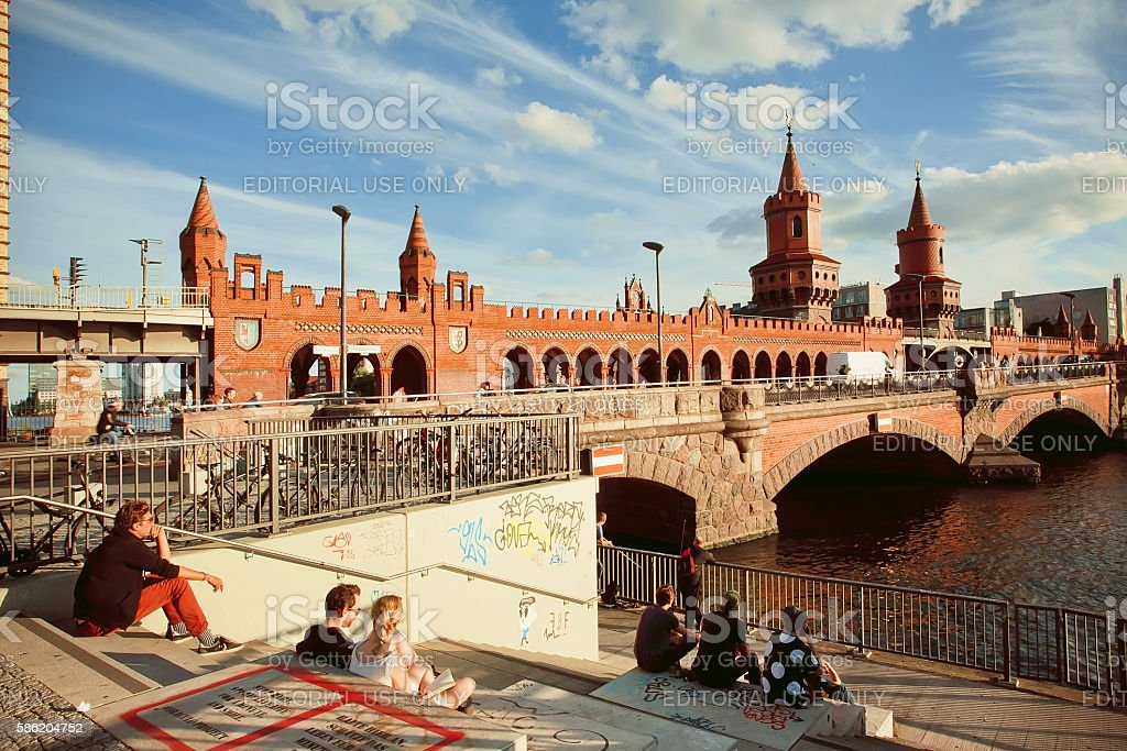 People sitting at riverbank of Berlin stock photo