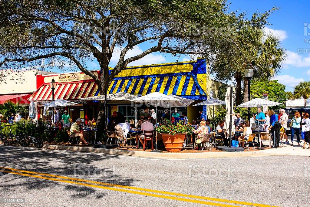 People sitting at sidewalk restaurant tables in Sarasota FL stock photo