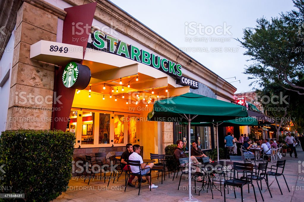 People sitting at Starbucks Coffee in West Hollywood, USA stock photo