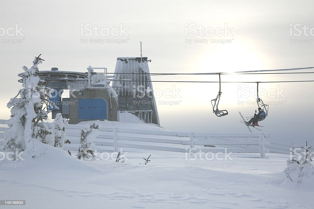 People sitting in a ski lift stock photo