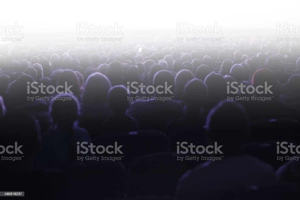 People sitting in an audience stock photo