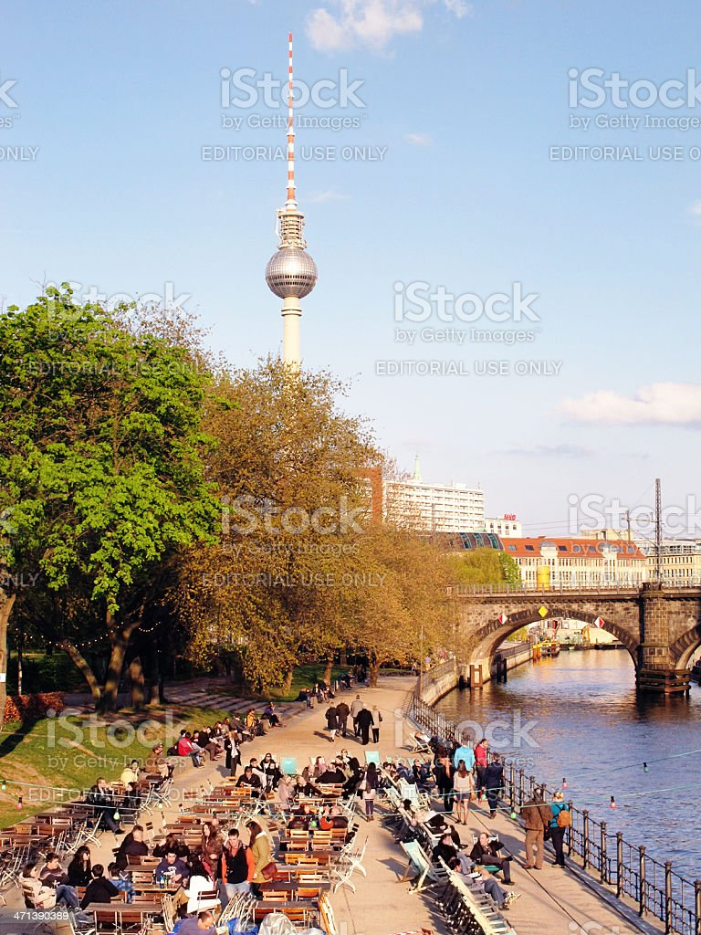 People sitting in beer garden at Spree River (Berlin) stock photo