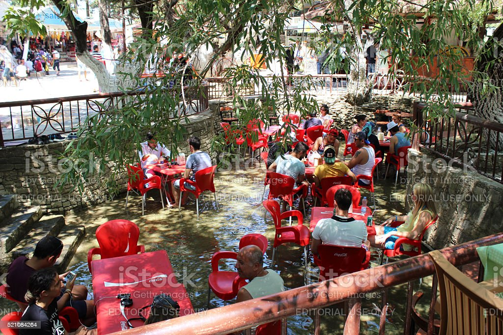 People sitting in cafe on Manavgat river stock photo
