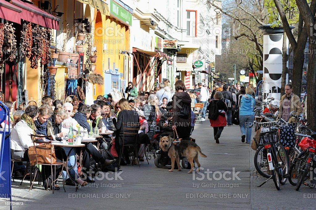 People Sitting in Sidewalk Cafes Berlin-Kreuzberg stock photo