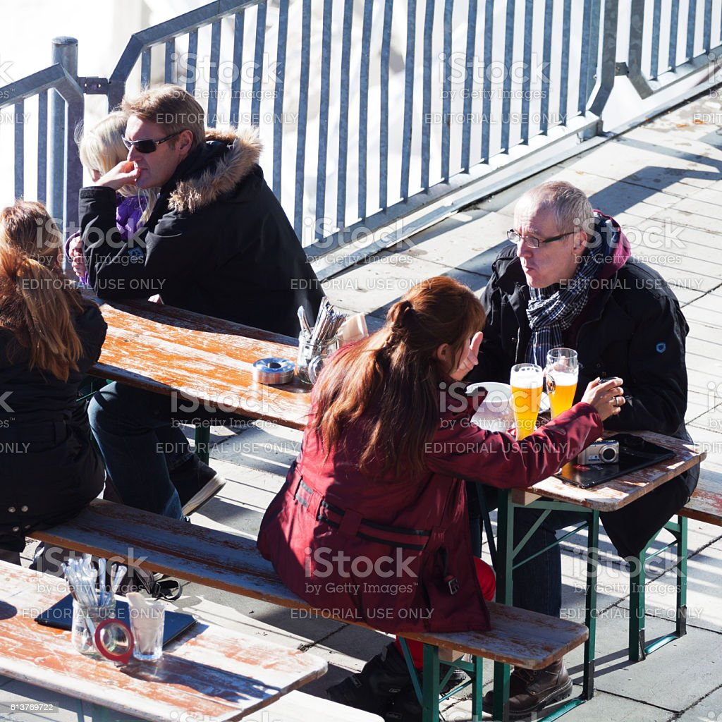 People sitting in sunshine and highest beergarden of Germany stock photo