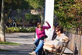 People sitting in sunshine