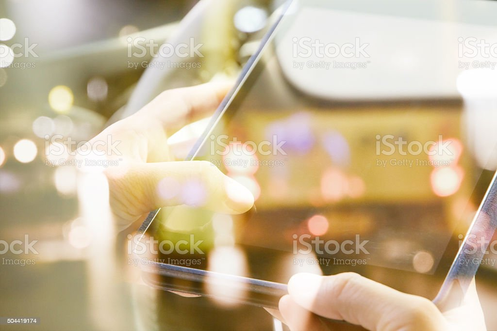 people sitting in the car using digital tablet stock photo