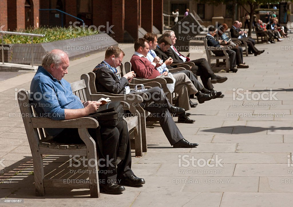 People Sitting in the Sun, Embankment Benches, London stock photo