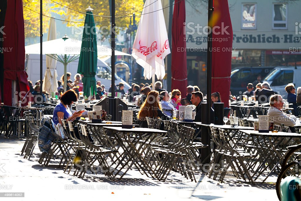 People sitting on square Alter Markt in Cologne stock photo