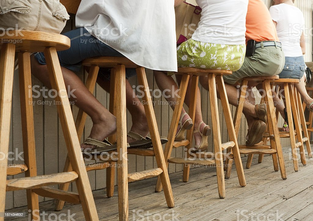 People Sitting On Stools at an Outdoor Bar - Barstools royalty-free stock photo