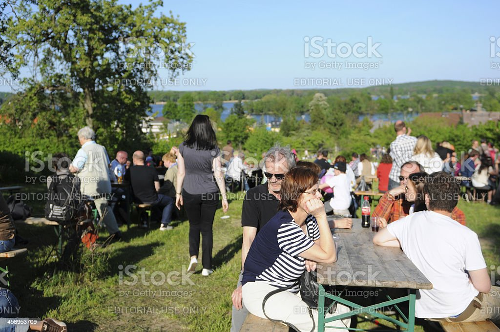 People sitting on tables at cherry tree celebration (Werder, Germany) stock photo