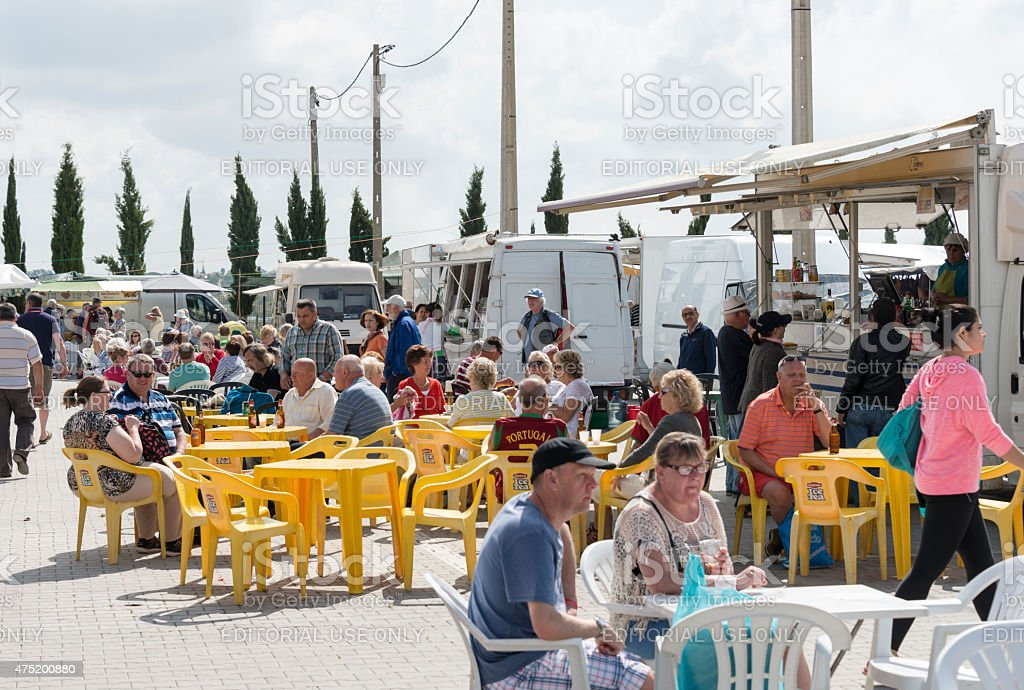 people sitting on teracce in loule portugal stock photo