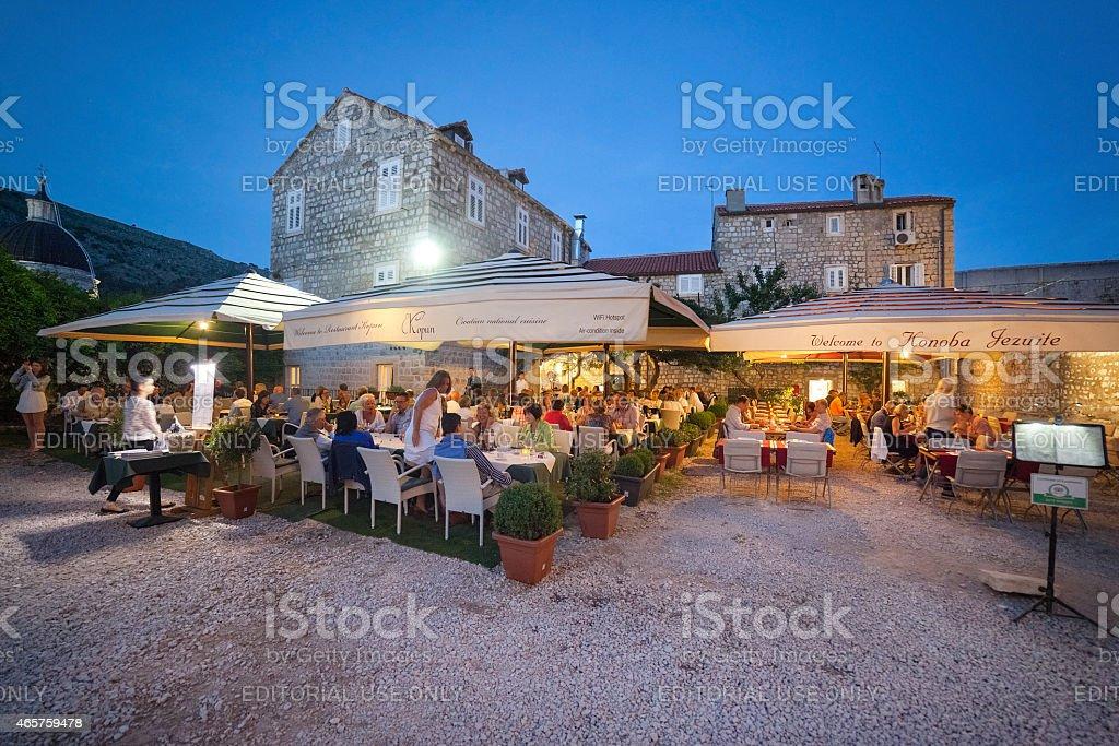 People sitting on terrace of Restaurant Kopun and Konoba Jezuite. stock photo
