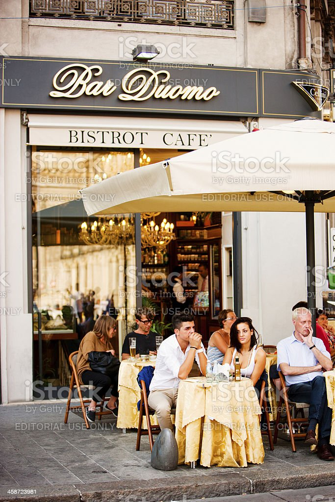 People sitting outdoors at Bar Duomo, Milan, Italy royalty-free stock photo