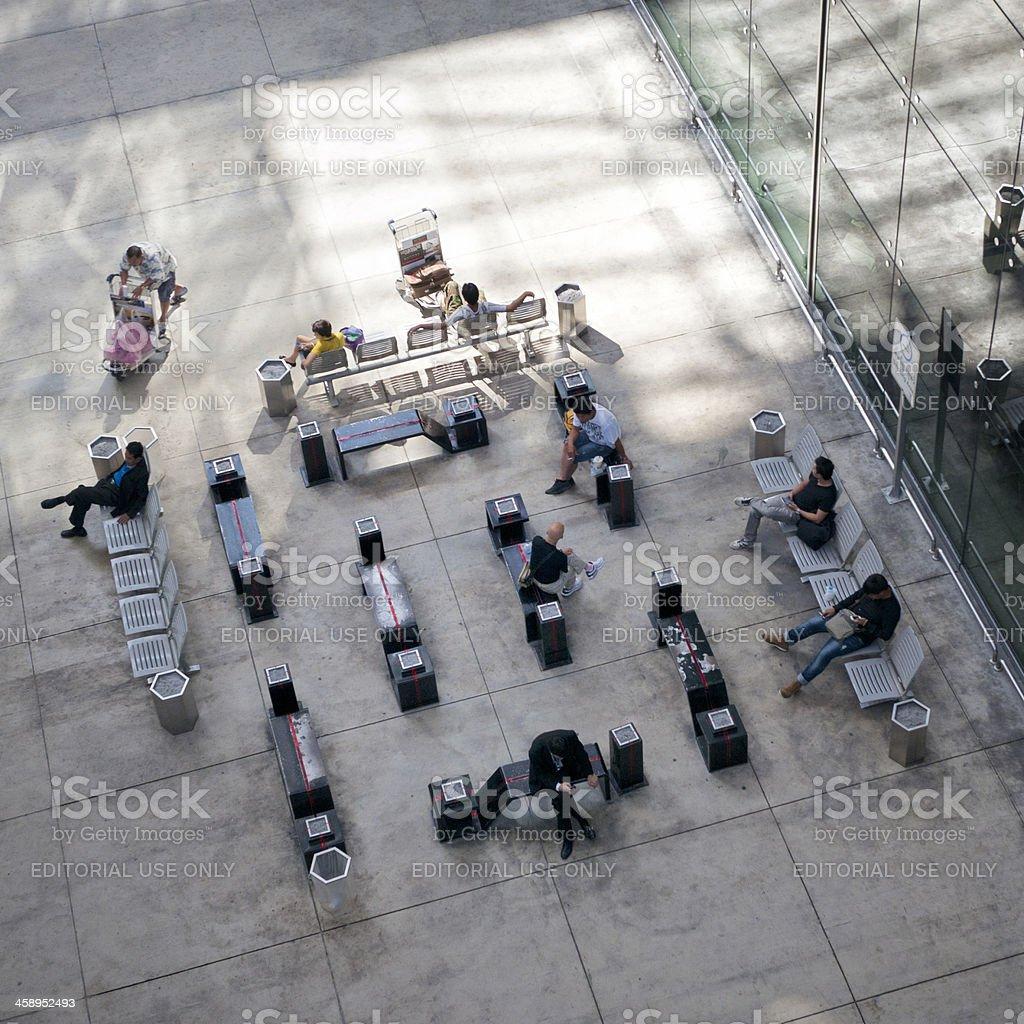 people sitting outdoors of terminal at Suvarnabhumi Airport Bangkok Thailand royalty-free stock photo